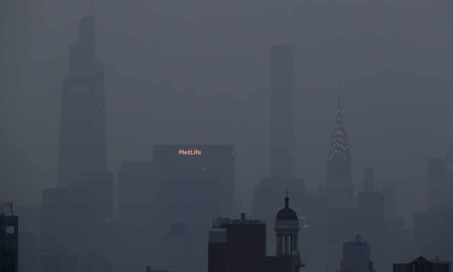 The Met Life and Chrysler buildings glow through a thick haze hanging over Manhattan, on Tuesday, in New York. Photograph: Julie Jacobson/AP