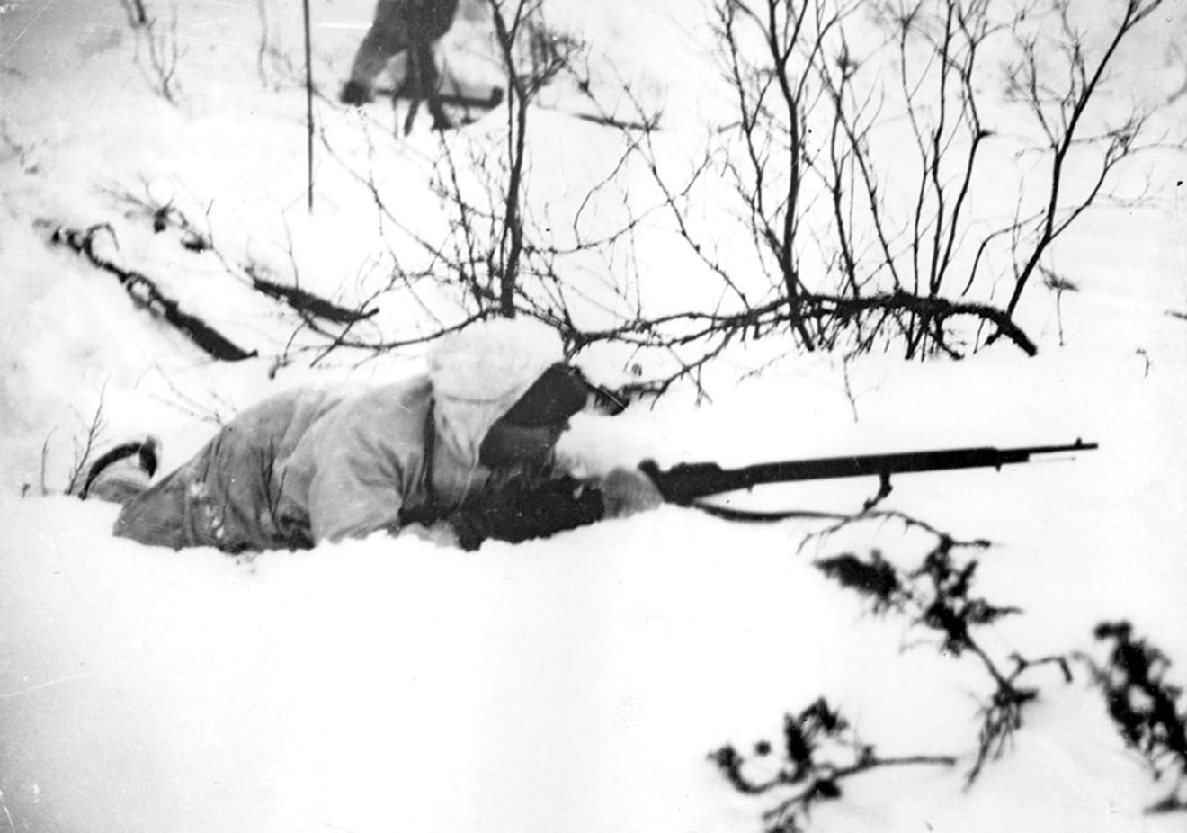 A Finnish soldier in position on the ground during the Winter War, 1940.