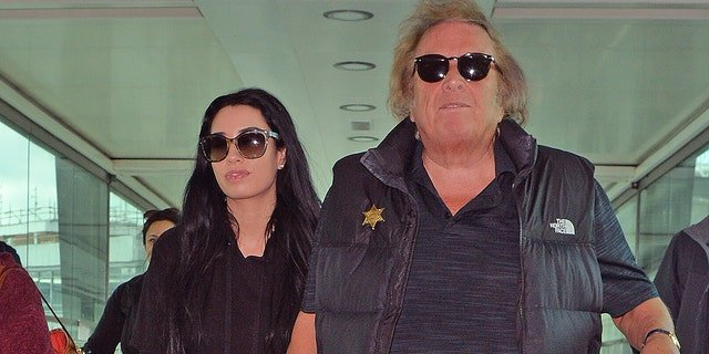 Don McLean and Paris Dylan arrive at Heathrow Airport on April 25, 2018 in London. The pair have been dating since McLean