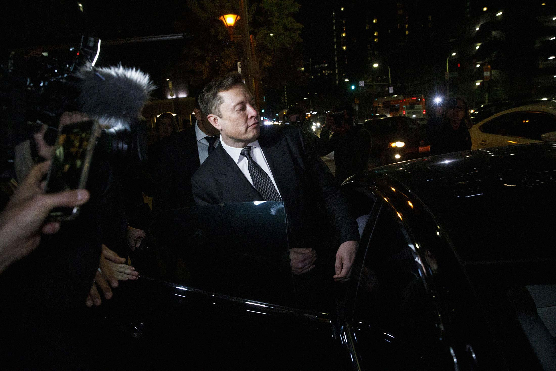 Musk departs federal court in Los Angeles on Dec. 3, 2019.