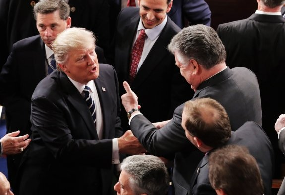 President Trump talks with Republican Rep. Peter King of New York after addressing a joint session of Congress in February.