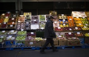 A customer walks past a display of produce at the Hunts Point Terminal Produce Market in the Bronx. Photograph: John Taggart/Bloomberg via Getty Images