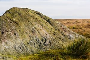Cup and ring marks on the ancient Badger Stone. Photograph: Ashley Cooper/Alamy