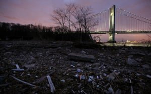 Debris sits on a still-closed beach area damaged by flooding from Hurricane Sandy near the Verrazano-Narrows Bridge in Staten Island, on 1 March 2013. Photograph: Mario Tama/Getty Images