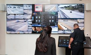 The Pittsburg police captain, Patrick Wentz, and the deputy district attorney for Contra Costa county, Mary Knox, monitor the Freeway Security Network command center, a system used to track down suspects in freeway shootings. Photograph: Tim Hussin/The Guardian