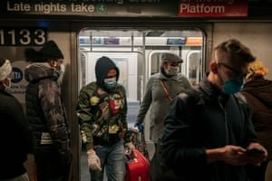Commuters wear face masks as they exit a subway train on 17 April in New York. Photograph: Scott Heins/Getty Images