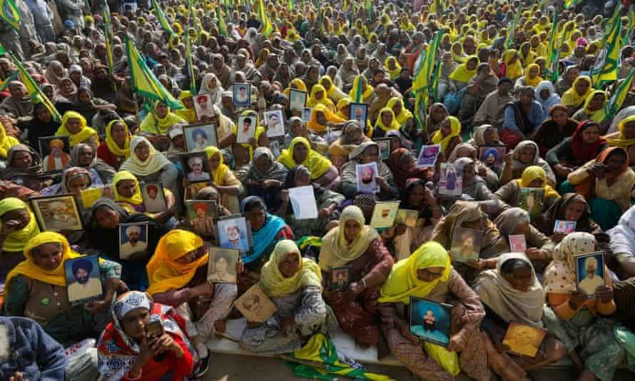 Women, including widows and relatives of farmers believed to have killed themselves over debt, protest against farm bills passed by India's parliament, at Tikri border near Delhi. Photograph: Anushree Fadnavis/Reuters