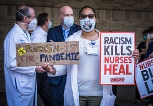 Nurses take a stand for racial justice outside of Bellevue hospital in New York City, in June. Photograph: Steve Sanchez/Pacific Press/REX/Shutterstock
