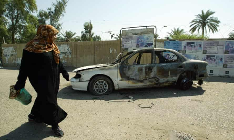A burnt-out car at the site where Blackwater guards opened fire in western Baghdad on 16 September 2007. Photograph: Ali Yussef/AFP/Getty Images