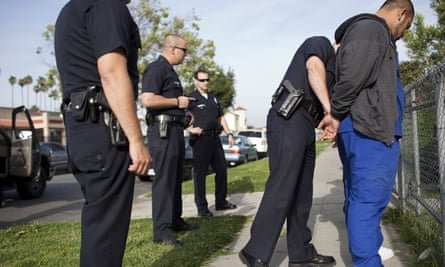 Police officers arrest a man in Los Angeles. Photograph: Robert Nickelsberg/Getty Images