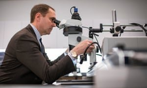 James Martin using his stereo fluorescence microscope in his New York lab. Photograph: Joshua Bright/The Guardian