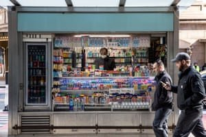 A newsstand stays open – but many shops and business have been forced to close. Photograph: Jeenah Moon/Reuters