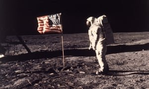 Buzz Aldrin with a nylon US flag planted on the moon in 1969. Photograph: Neil Armstrong/AP