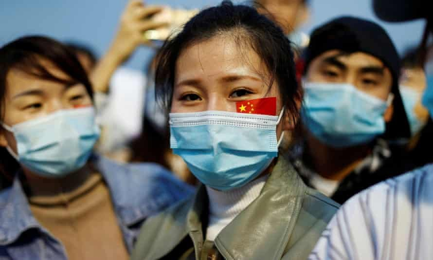 People wearing face masks at a Beijing ceremony to mark the 71st anniversary of the founding of People's Republic of China in October. Photograph: Carlos García Rawlins/Reuters