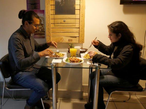 Two people eating.David Mercado/Reuters