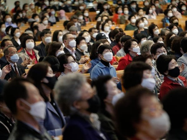 People wearing face masks attend a service at the Yoido Full Gospel Church in Seoul, South Korea, on May 10.Associated Press