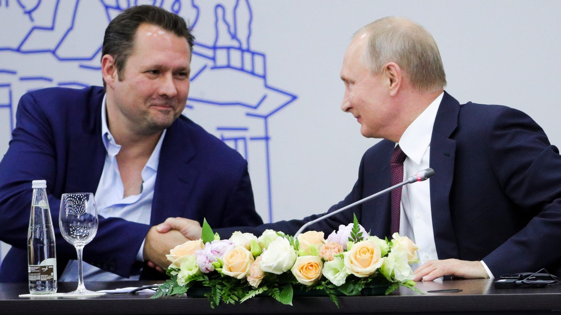 Hyperloop Transportation Technologies co-founder Dirk Alhorn shaking hands with Putin. Did someone say large pool of institutional capital?
