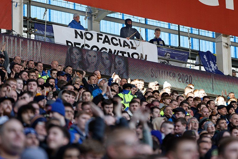 A banner protests against facial recognition at a football match this January in Cardiff, UK