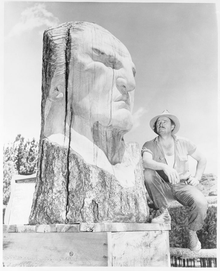 Korczak Ziolkowski poses next to an early design for the sculpture's face, in 1955.