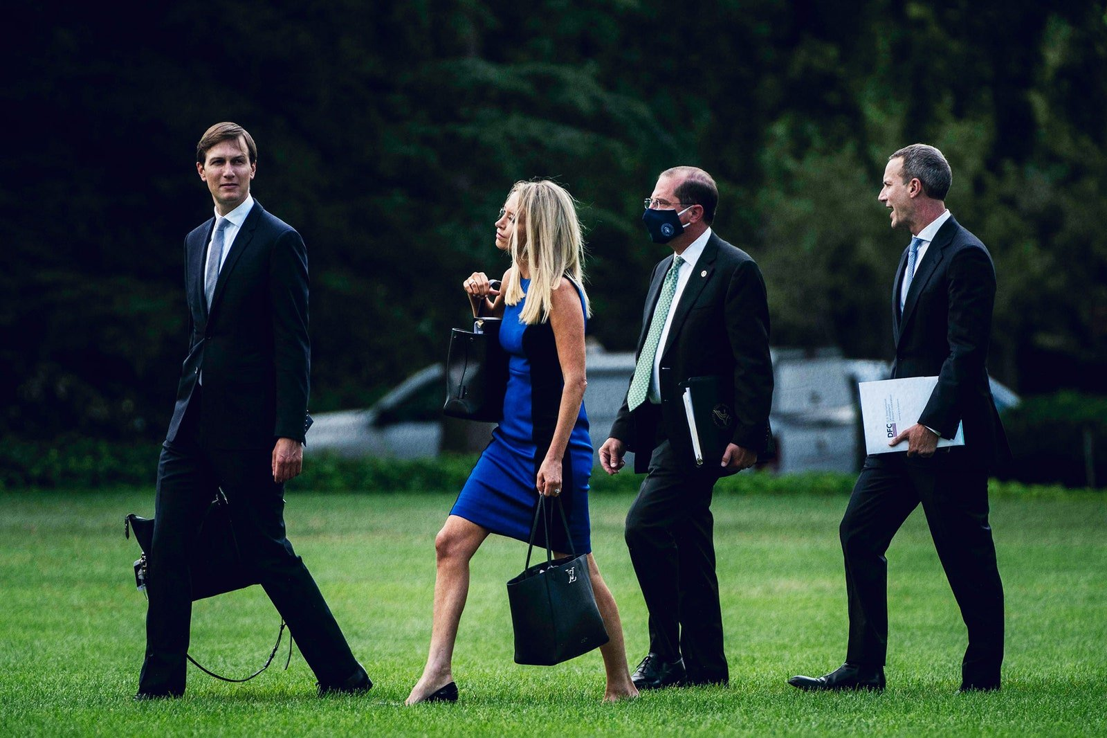 From left, Kushner, press secretary Kayleigh McEnany, Health and Human Services HHS Secretary Alex Azar, and Chief Executive Officer of the United States International Development Finance Corporation Adam Boehler boarding Marine One, July 27, 2020.By Jabin Botsford/The Washington Post/Getty Images.