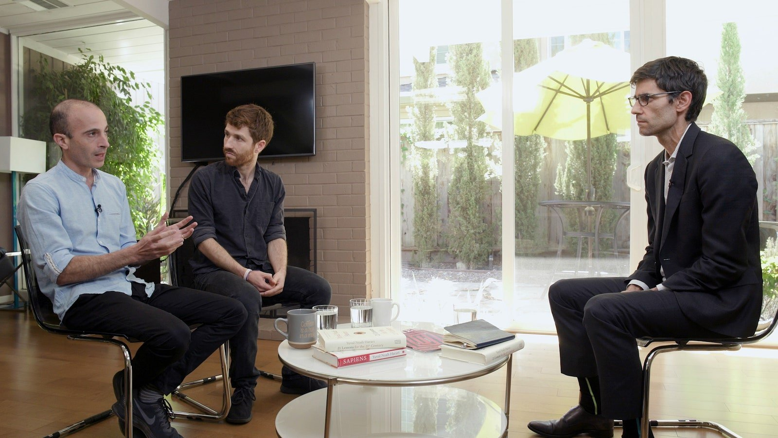 Yuval Noah Harari, left, and Tristan Harris with WIRED editor in chief Nicholas Thompson.