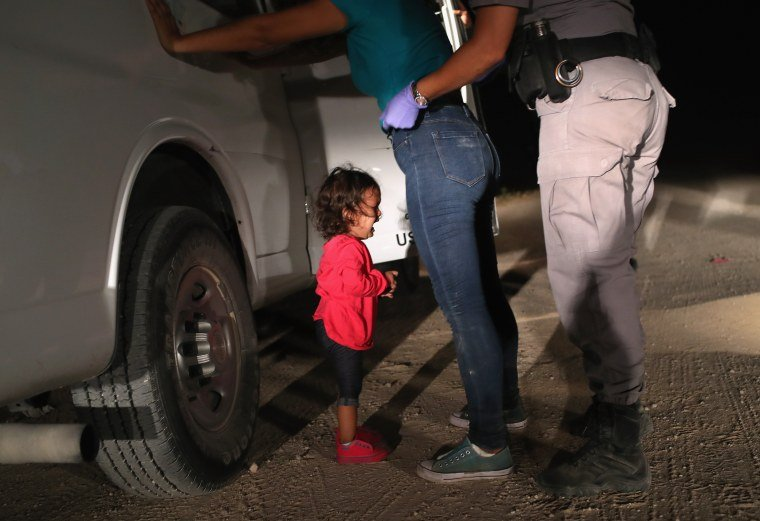 A two-year-old Honduran asylum seeker cries as her mother is searched and detained near the U.S.-Mexico border in McAllen, Texas on June 12, 2018.John Moore / Getty Images file