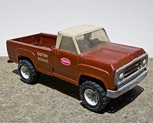 """Toy pick-up truck with """"Eastern Roofing"""" painted on the bed, a boyhood gift from father to son. Photo by Lisa Larson-Walker/Slate."""