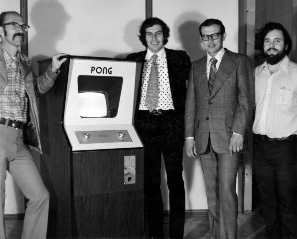 Atari's Ted Dabney, Nolan Bushnell, Larry Emmons, and Alan Alcorn pose with Pong.