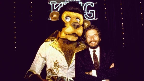 Bushnell poses with the King, one of Chuck E. Cheese's Pizza Time Theatre pals. Photo by Terry Ashe / The LIFE Images Collection / Getty Images.