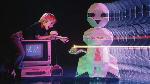 Androbot's Topo, which could be controlled via an Apple II PC, delivers an apple. Photo © Roger Ressmeyer / CORBIS / VCG via Getty Images.