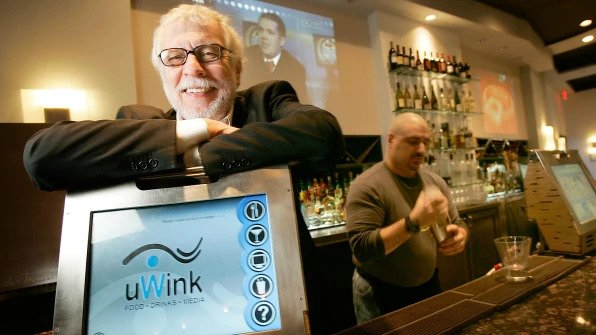 Bushnell in 2007 at uWink, his eatery equipped with touchscreen game machines. Photo by Brian Vander Brug / Los Angeles Times via Getty Images.