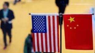 Cờ Trung Quốc và Hoa Kỳ. Ảnh minh hoạ.                © AFP