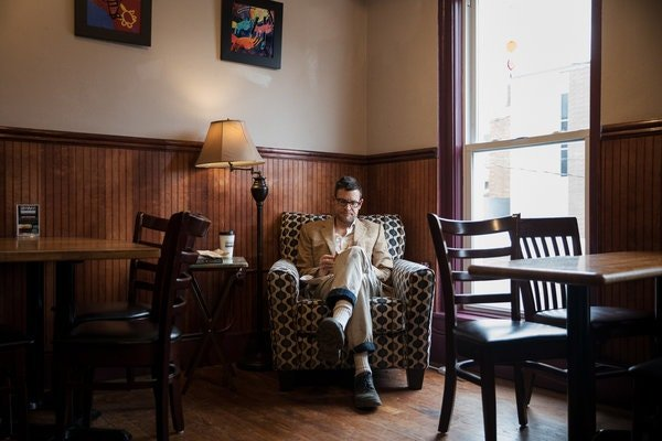 Erik Hagerman sits down with his sketch book, in his regular seat, in the same room, with his same triple, whole milk latte and cranberry scone he has each day at Donkey Coffee.