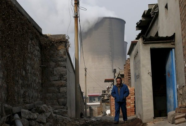 A cooling tower at a coal-fired plant in Hebei Province, China. More than 4.3 million workers are employed in the country's coal mines.