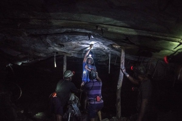 Miners reinforced the roof of a coal pit in Telangana.