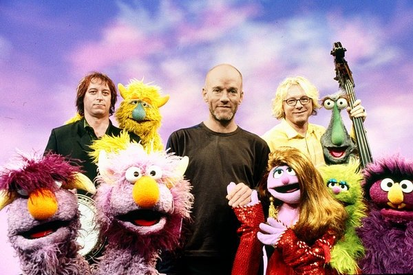 "R.E.M.'s Peter Buck, Michael Stipe and Mike Mills stuck around the set after their ""Sesame"" taping, one of the show's songwriters said."