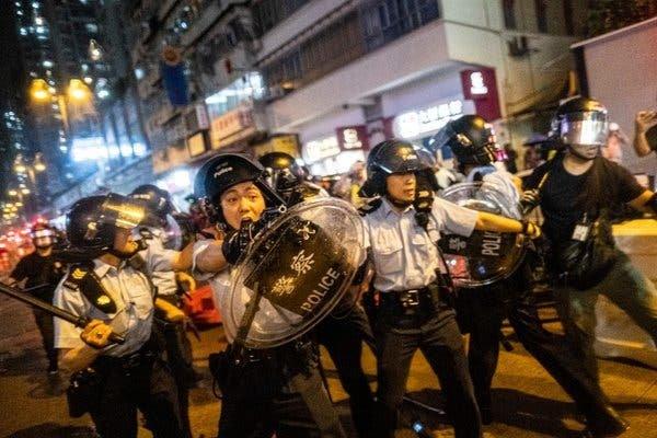Police officers aimed guns at protestors in the Tsuen Wan district of Hong Kong on Sunday. The confrontations followed a peaceful march by more than 10,000 people.