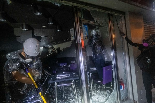 Protesters damaged shops that they believed had ties to pro-government supporters in the Tsuen Wan district.