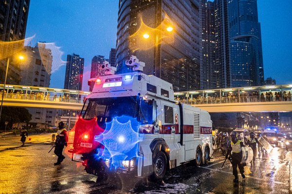 A police vehicle equipped with a water cannon in Tsuen Wan on Sunday. It was the first time since since the protests began that the trucks were used.