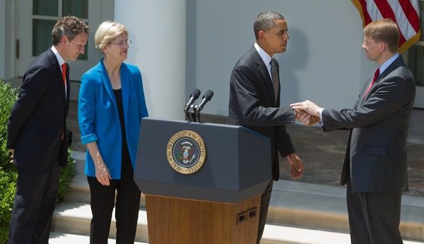 President Barack Obama introducing Richard Cordray, right, as his nominee for director of the Consumer Financial Protection Bureau, in 2011. There was strong Republican opposition to Ms. Warren becoming the permanent director.