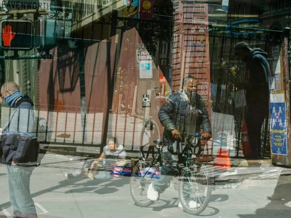 People in the Tenderloin District of San Francisco, in an image made by a double exposure