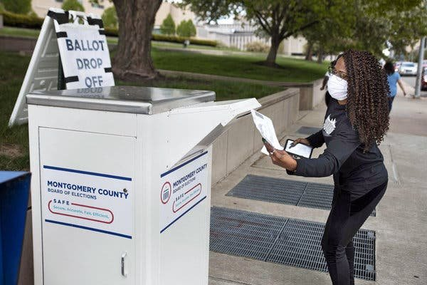 A voter dropped off a ballot that was mailed to her in Dayton, Ohio, last month.