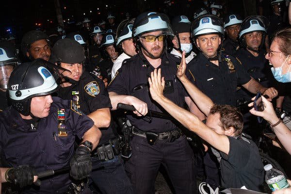 Officers surround protesters in Brooklyn on Wednesday before making arrests.
