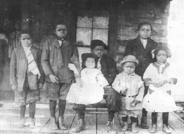 Ron Graham's father, Theodore Graham, center, as a youth with his youngest sibling, Rowena, on his lap, in a photograph from around 1912. Mr. Graham spent decades assembling documentation showing that he is a citizen of the Muscogee