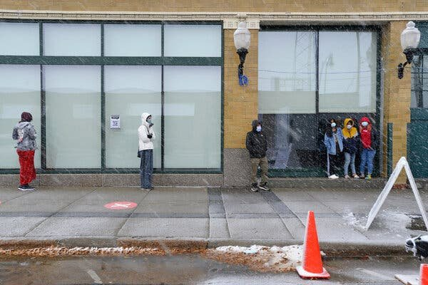 A virus testing line in downtown Fargo, N.D., on Tuesday. North Dakota is leading the nation in coronavirus cases per capita.