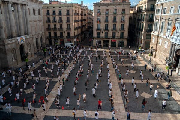 A doctors' protest in Barcelona last month. Spanish medics are confronting a second wave of coronavirus with better protective equipment but lower morale.