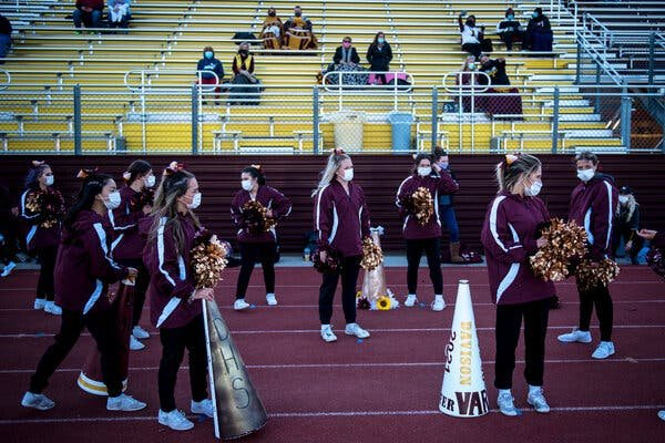 A high school football game in Davison, Mich., in September. Michigan will suspend all in-person learning for high school and college students for three weeks.