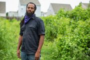 Duron Chavis at an urban farm in Richmond, Va., one of several built to address rising heat and a lack of grocery stores nearby.