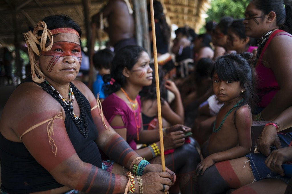 Indigenous Tembé eomen listen to speakers during a meeting of tribes at the Tekohaw indigenous reserve in Pará, Brazil, on Sept. 3, 2019.