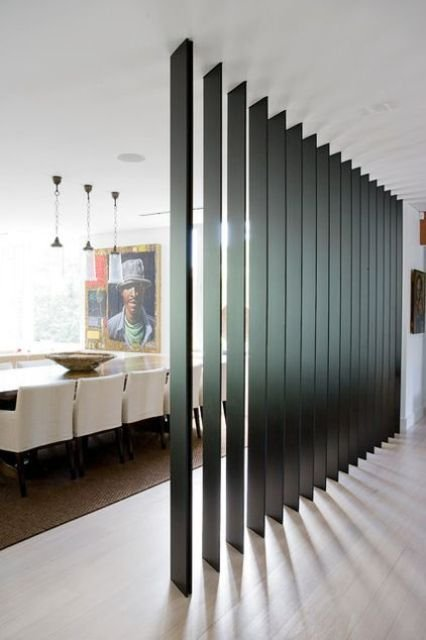 dark wooden slats can be a nice room divider as they let light in and look contemporary and chic